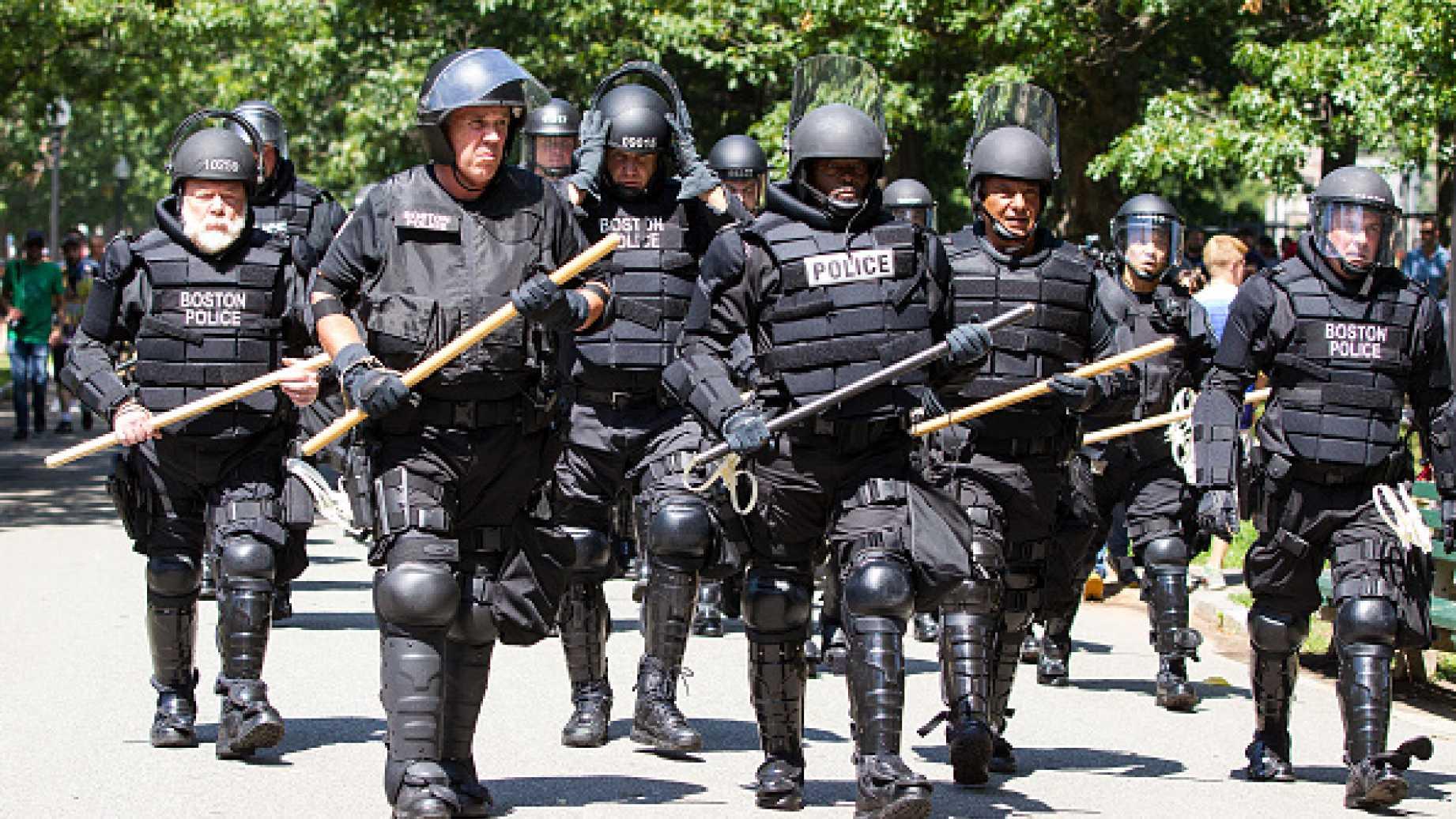 Militarized police in riot gear